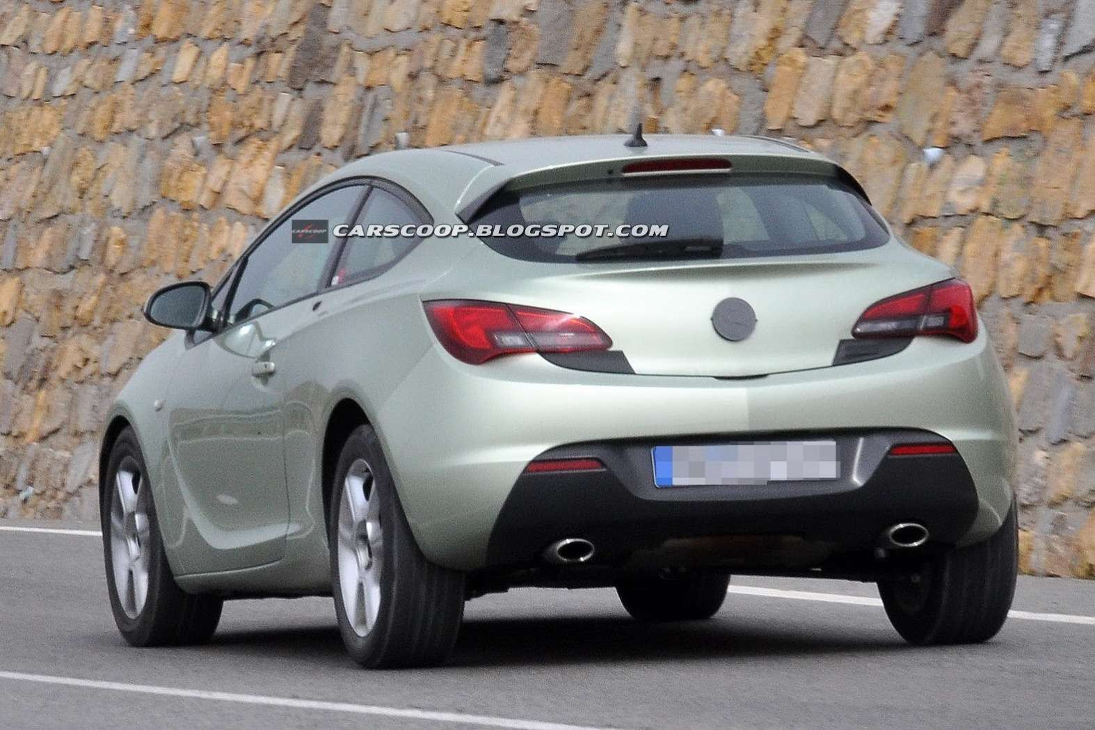 Facelifted Opel Astra GTC test prototype side-rear view_no_copyright