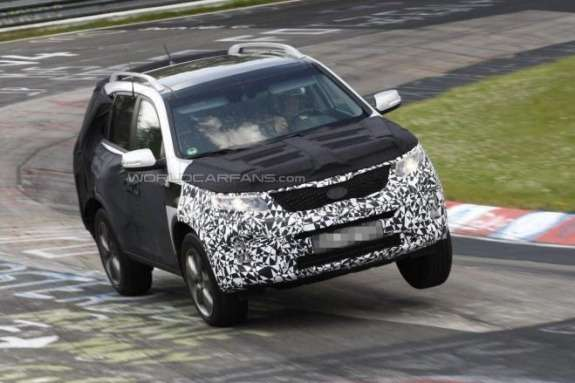 Facelifted Kia Sorento test prototype side-front view