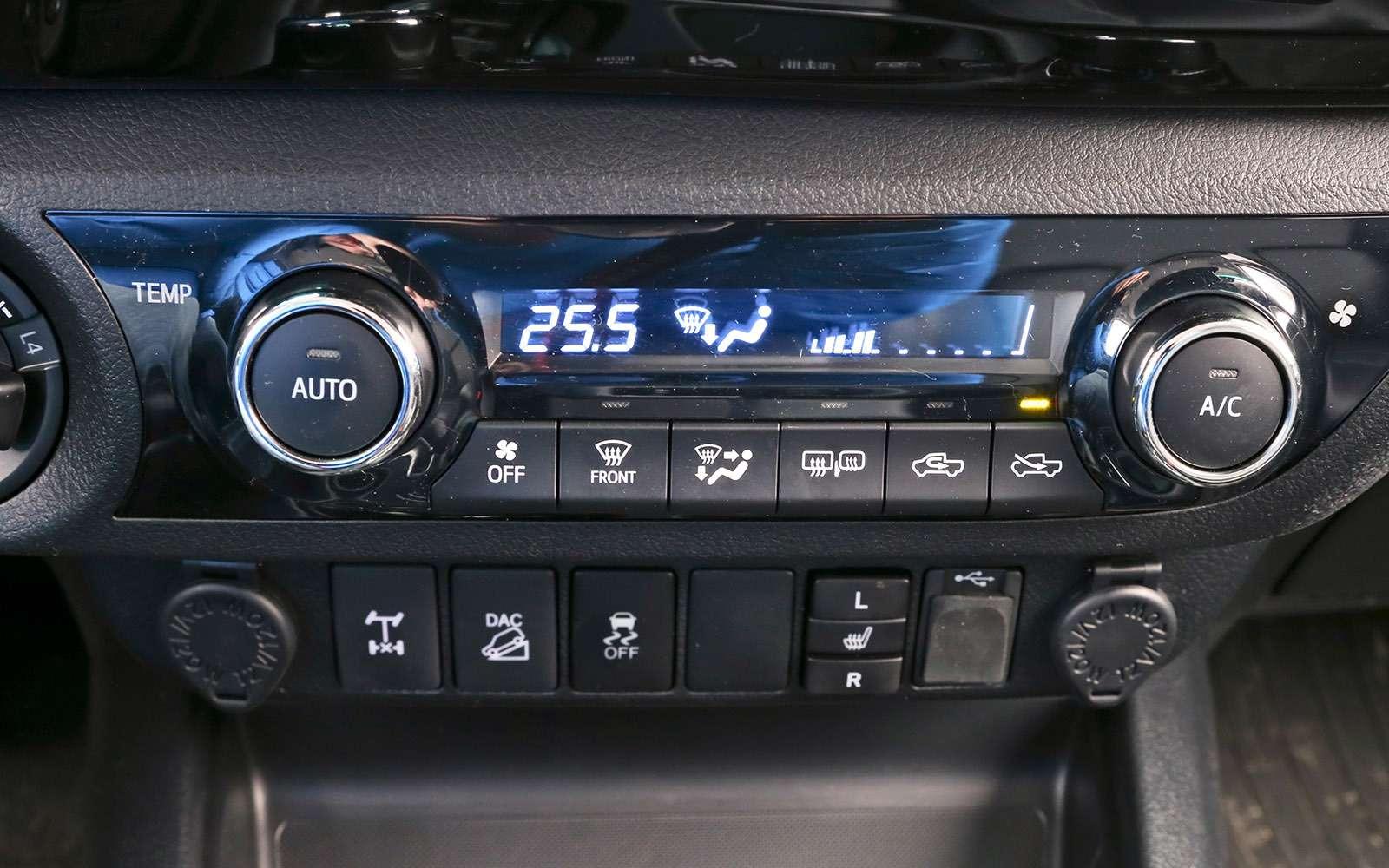 Пикапы Isuzu D-Max, Mitsubishi L200и Toyota Hilux: на«обортаж»!— фото 698440