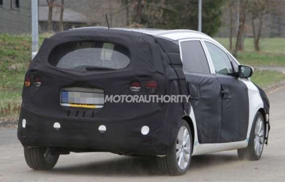 New Kia MPV test prototype side-rear view