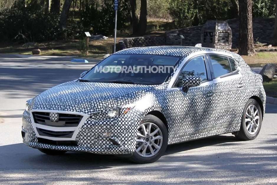 New Mazda3 hatchback test prototype side-front view_no_copyright