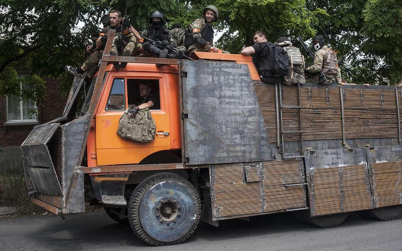 Грузовики боевого назначения: гантраки вАфгане, Украине иСирии— фото 911490