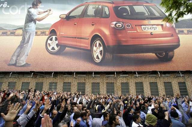 Brazilian Volkswagen workers raise their arms voting tostart ageneral strike atAnchieta plant inSao Bernardo doCampo