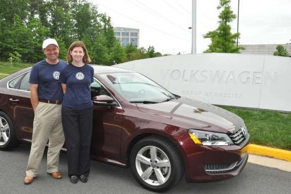 John and Helen Taylors next to a record-breaking VW Passat