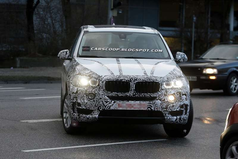 2014-BMW-X5-Less-Camo-13_no_copyright