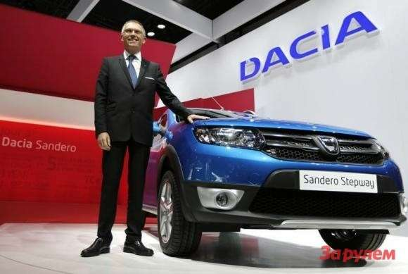 Renault Chief Operating Officer Carlos Tavares poses next to the new Dacia Sandero on media day at the Paris Mondial de l'Automobile