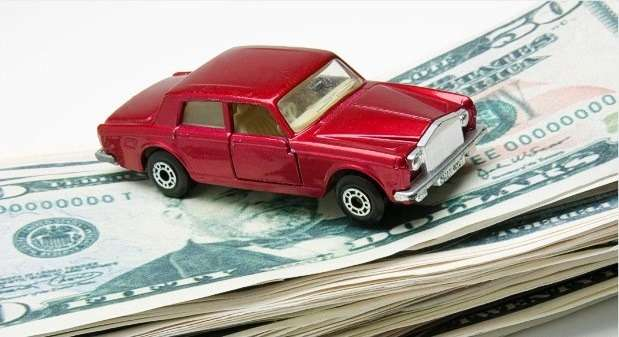 Miniature car onstack ofmoney
