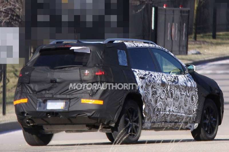New Jeep Cherokee test prototype side-rear view_no_copyright