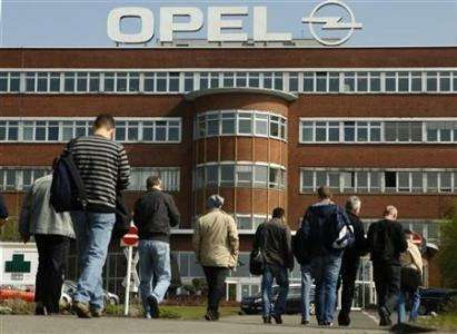 Workers arrive for their change ofshift atthe Opel plant ofBochum