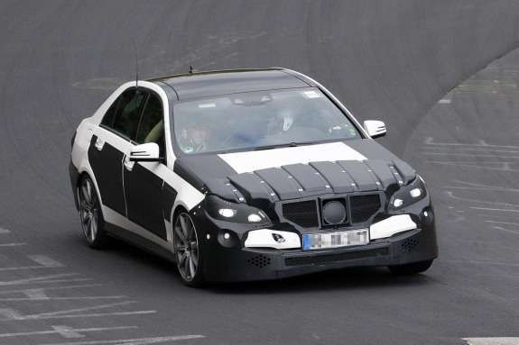 Restyled Mercedes-Benz E 63 AMG test prototype side-front view_no_copyright
