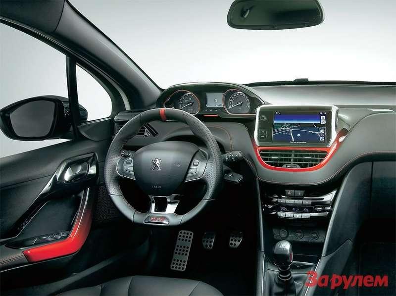 Алеющие пластиковые панельки, алюминиевые накладки органов управления, ухватистый руль— функциональные признаки самой быстрой версии.