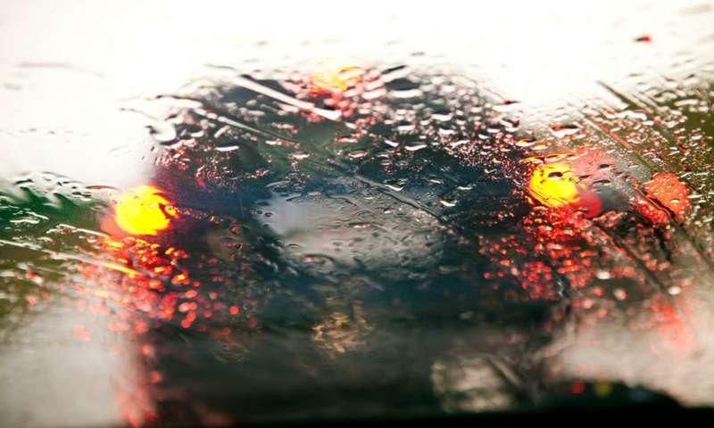 Carwindshield intraffic jam during rain