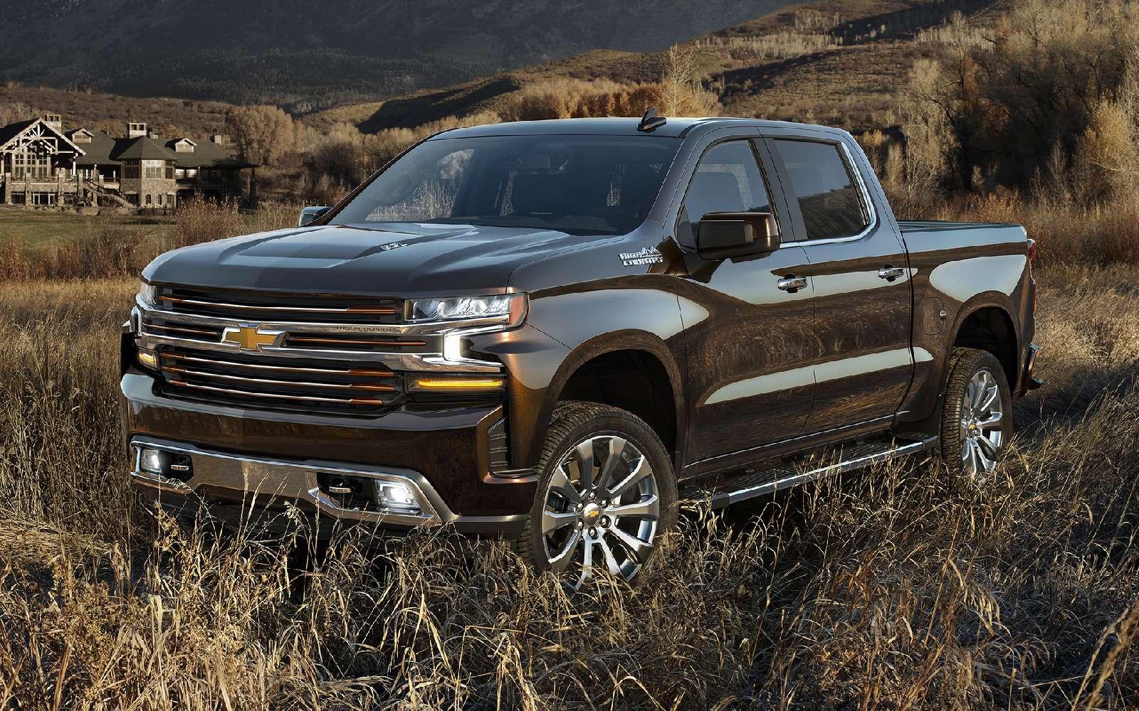 В погоне залидером: представлены новые Chevrolet Silverado иRam 1500— фото 836113