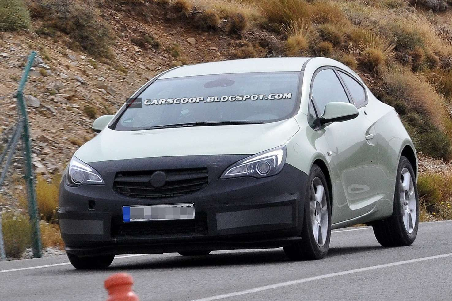 Facelifted Opel Astra GTC test prototype side-front view_no_copyright