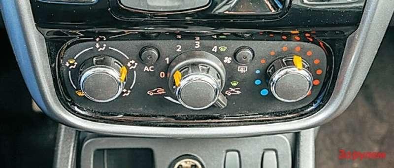 Renault Duster Управлять климатом удобнее, чем в«Логане», ноненамного.