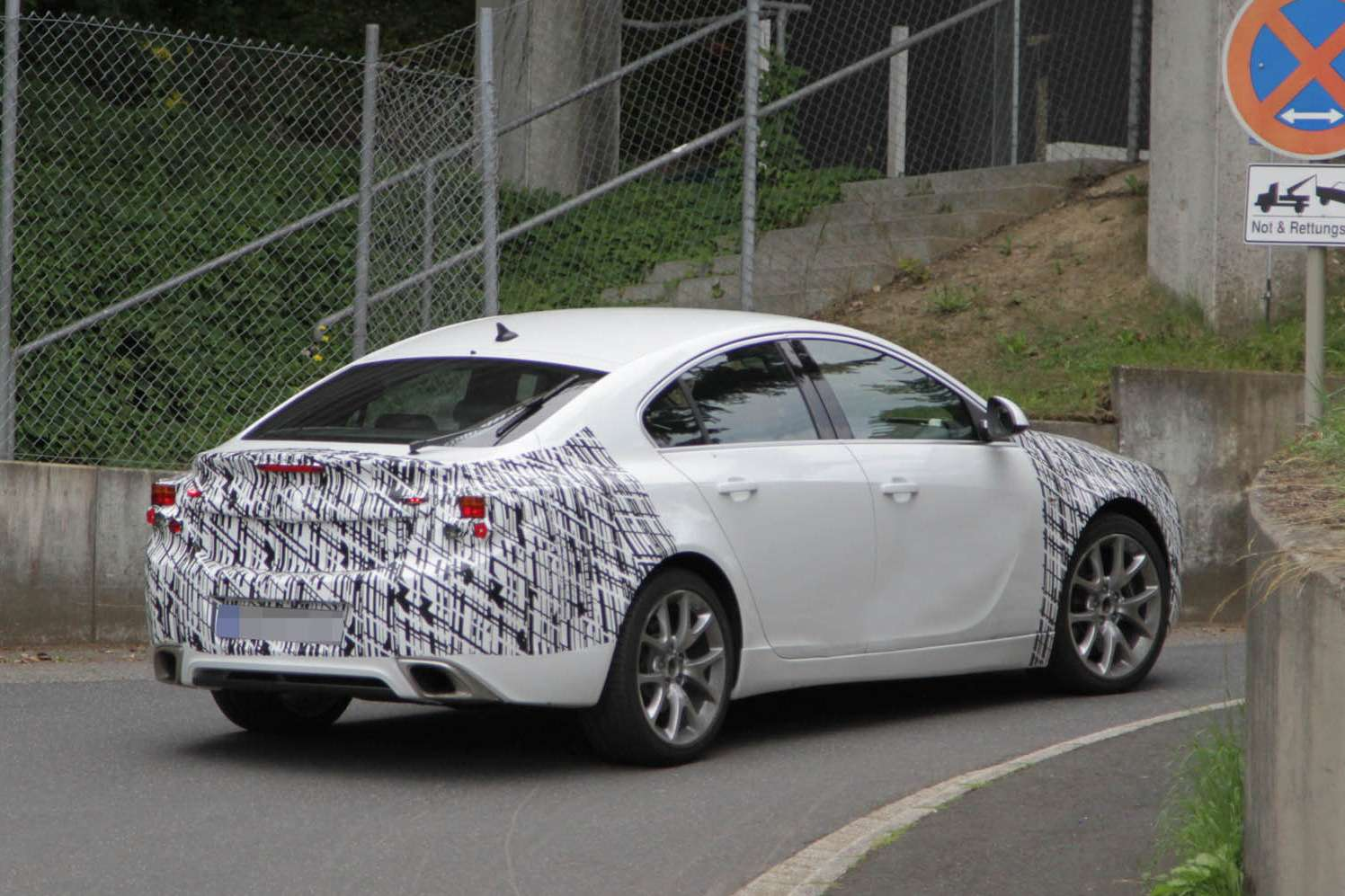 Facelifted Opel Insignia OPC test prototype side-rear view_no_copyright