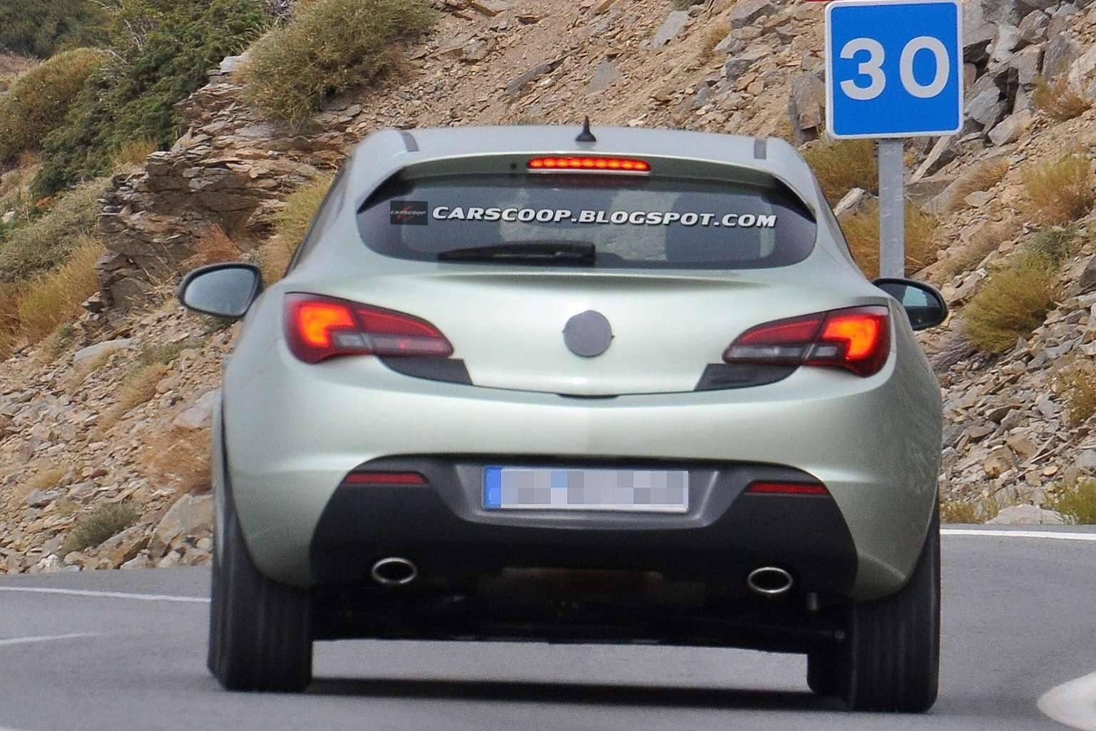 Facelifted Opel Astra GTC test prototype rear view_no_copyright