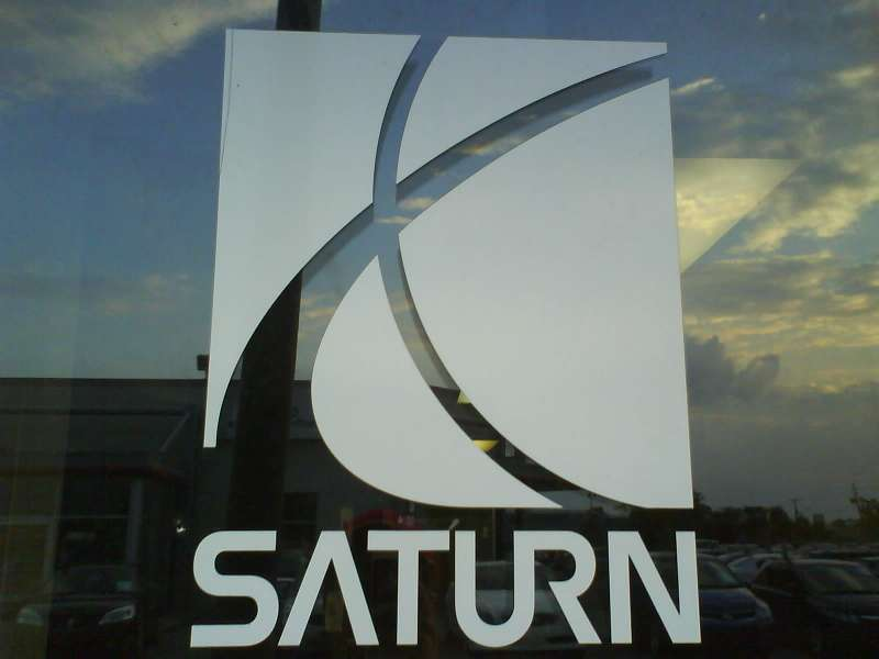 9 saturn logo with retailer reflection no copyright