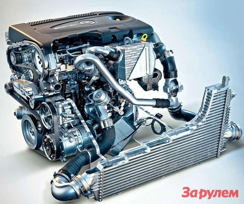 Интеркулер малой турбины (вверху) одет врубашку жидкостного охлаждения, поток длябольшого компрессора охлаждается набегающим воздухом. Блок цилиндров взят от160‑сильной версии мотора инемного доработан.