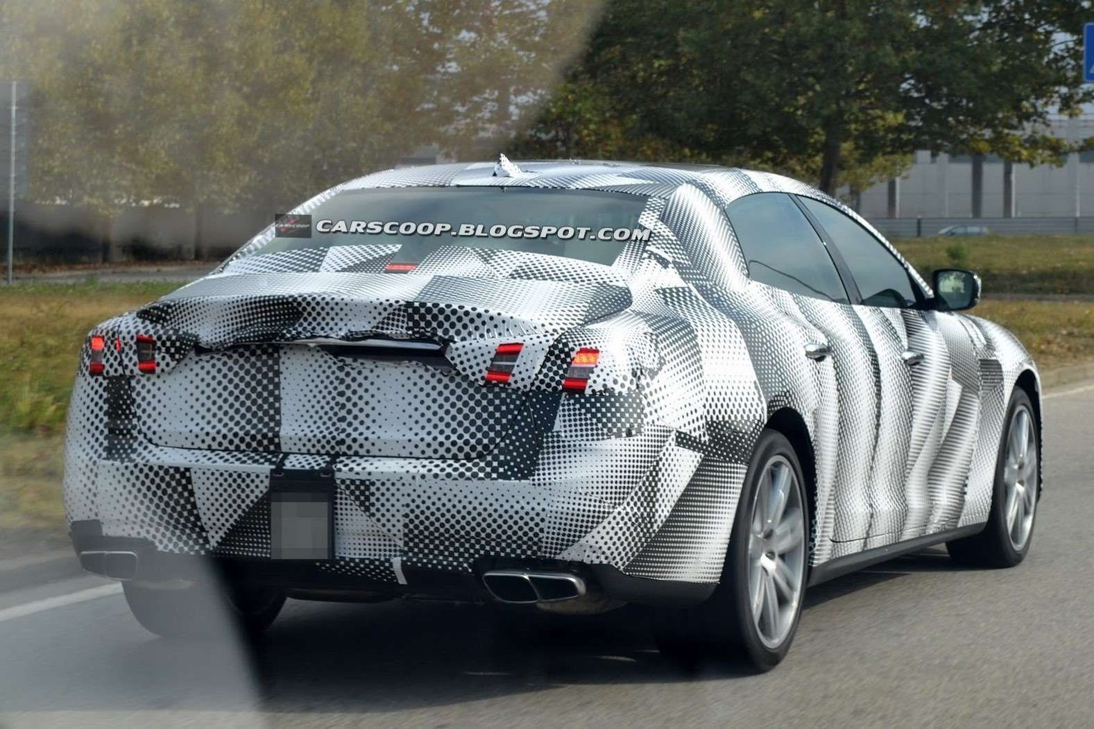 NewMaserati Quattroporte test prototype side-rear view 1_no_copyright