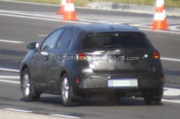 New Toyota Corolla hatchack test prototype side-rear view