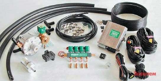 Главное отличие ГБО четвертого поколения: сюда входит электронный блок управления,  газовый редуктор ивыносные электромагнитные форсунки, смонтированные нарампе