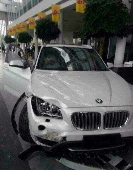 no copyright bmw x1 crashed into dealership
