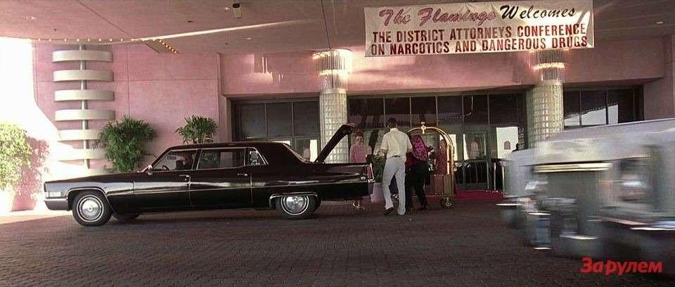 Надпись набаннере: приветствуем участников конференции. Напереднем плане Cadillac Fleetwood 75.