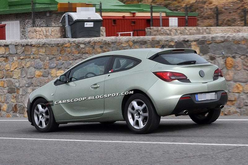 Facelifted Opel Astra GTC test prototype side-rear view 2_no_copyright